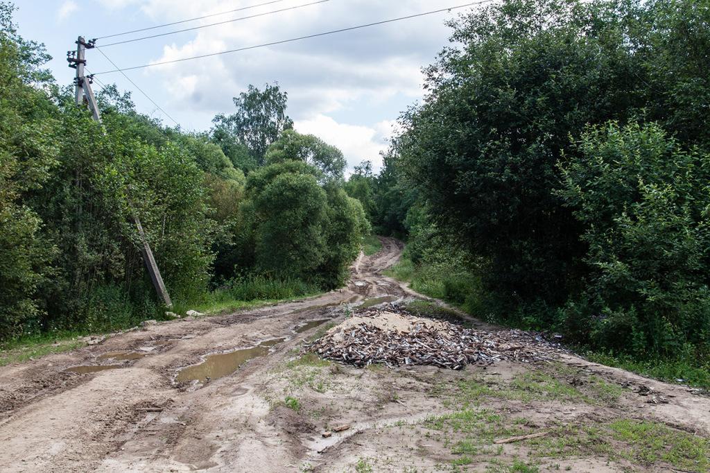 погана дорога, фото сільської дороги, колія